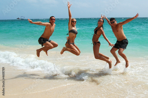 People jumping in the ocean