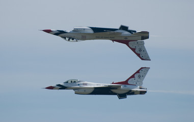 Two Thunderbird jets flying inverted