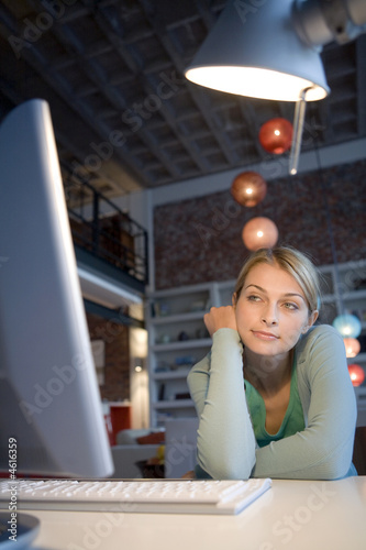 A young woman at her computer
