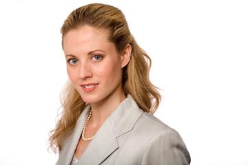 Portrait of Attractive Businesswoman in Gray Suit