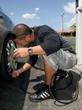 Man Performing Car Maintenence