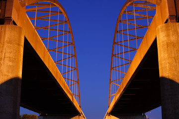 Cedar highway bridge against deep blue sky