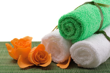Spa concept of green color: the towel, soap and candles over sis