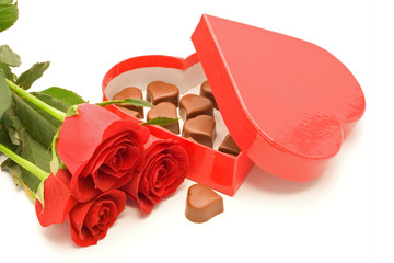 Roses and chocolate in heart shaped box