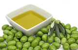 Olive oil in a bowl with fresh green olives poster
