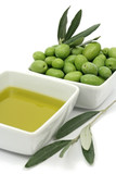 Fresh green olives and olive oil in square bowls poster