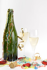 Champagne celebration party with bottle, glasses and decoration