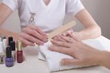 Professional manicurist filing clients finger nails poster