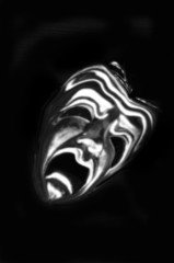 The mask of tragedy rendered as a ghost