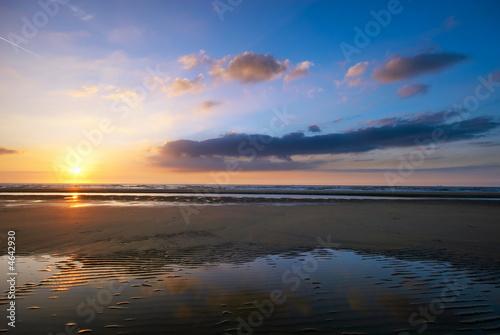 Leinwanddruck Bild sunset on the beach