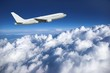 Large airliner along clouds