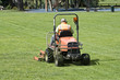 Man on Ride-On mower cutting grass - 4648743