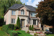 Two storey landscaped house with willow tree