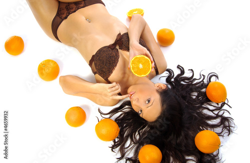 Sexy girl with orange fruit