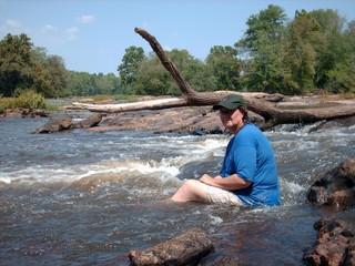 Woman sitting in rapids 2