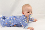 Baby in jammies on white backdrop poster
