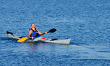 Kayaker emerges after float-asisted roll poster