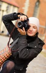 Beautiful girl with a digital camera
