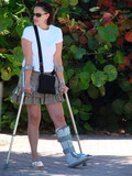 pretty girl with a broken ankle poster