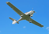 Bottom view of light hobby aircraft in flight poster