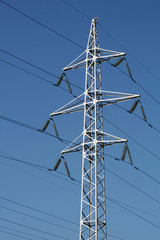 Electric main against a blue sky.