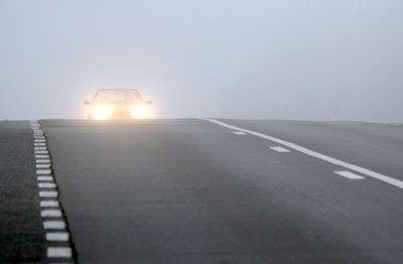 Car appearing through fog
