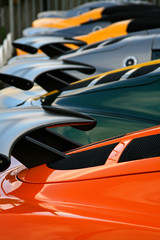 row of supercar rear spoilers