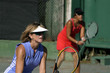 middle aged females playing tennis doubles
