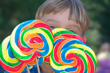 boy with lollipops