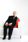Bald Businessman on Chair