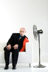 Bald Businessman with Fan