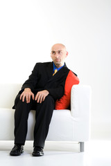 Bald Businessman on Chair