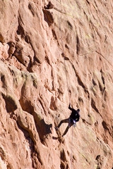 Rock Climber on Red Sandstone