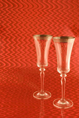 Two Champagne Glasses on Red Background