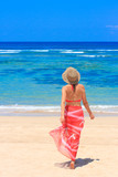 Girl in pareo walking towards the sea poster