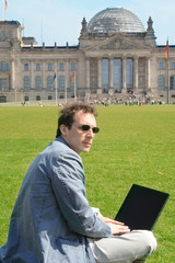 Man with laptop in Berlin