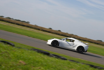 White sports car racing on track
