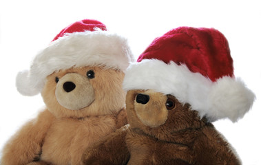 two teddy bears in Santa hats
