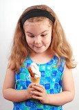 Studio photograph of child delighted with her ice cream poster