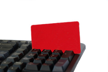 Red card in the black computer keyboard about numbers