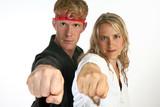 Martial arts man and woman punching poster