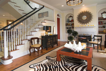 well decorated living area and staircase