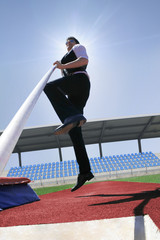 business man high jump