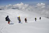 Five  climbers trekking down poster