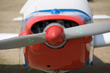 front of small aircraft with propeller poster