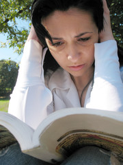 woman read a book before examination