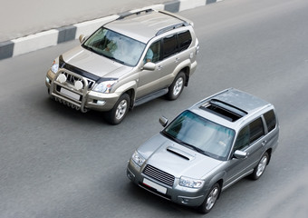 """two suv cars on road part of """"luxury cars"""" series"""