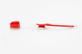 Red toothbrush with red toothpaste isolated poster