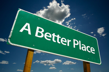 """A Better Place"" Road Sign with dramatic blue sky and clouds."