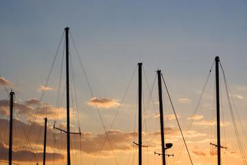 yacht masts at sunset